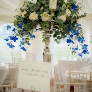 Candelabra wedding centrepieces at Sandon Hall with blue and white flowers by Passion for Flowers (1)