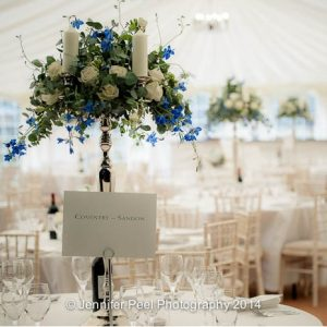 Candelabra wedding centrepieces at Sandon Hall with blue and white flowers by Passion for Flowers (2)