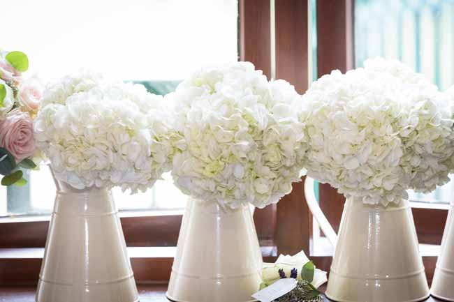 Cream hydrangea bridesmaids bouquets in jugs by Passion for Flowers