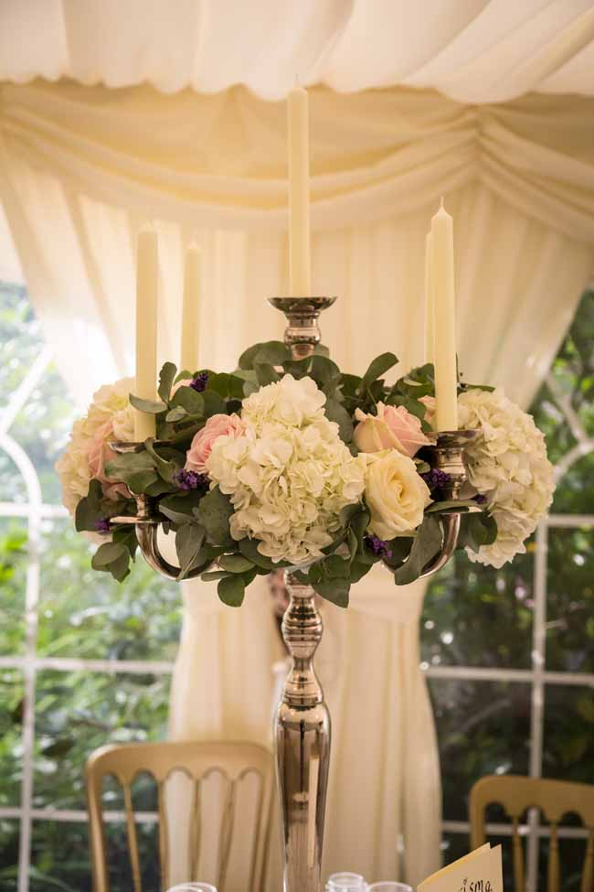 Tall candelabra wedding centrepieces at Birtsmorton Court by Passion for Flowers (1)