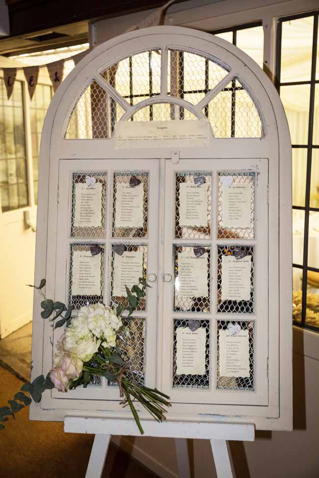 Window shutter wedding table plan by Passion for Flowers