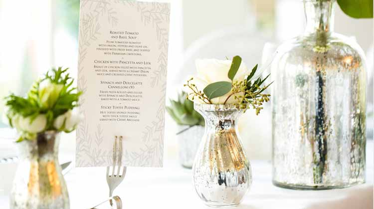 mercury silver vases with cream roses and eucalyptus winter wedding