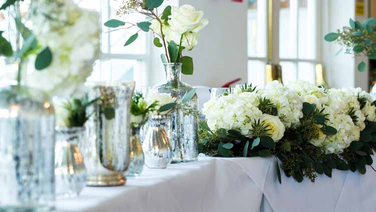 top table wedding flowers cream roses foliage and mercury silver vases warwickhouse winter wedding