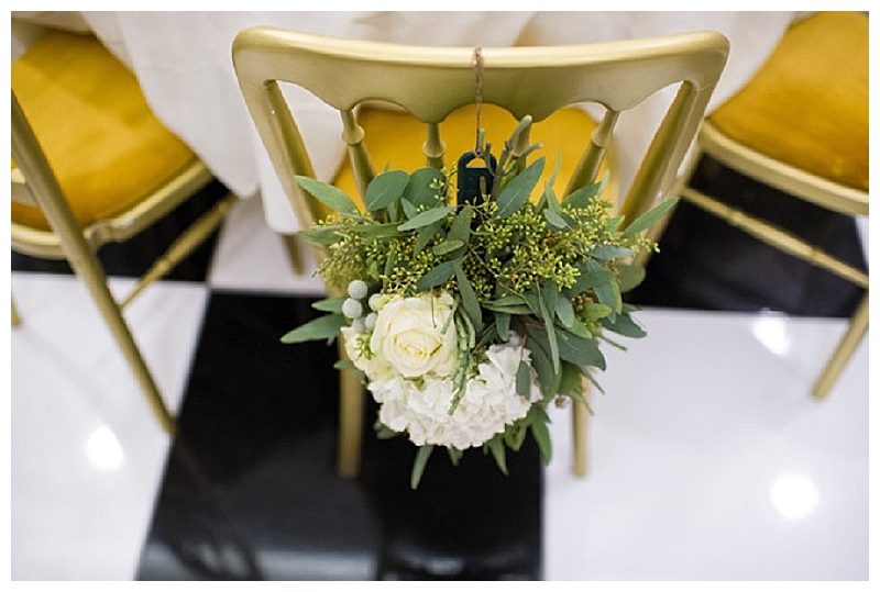 gold-white-green-wedding-flowers-chair-backs