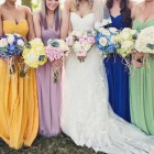 bridesmaids wearing different colours with different coloured bouquets blue yellow pink navy green lilac (1)