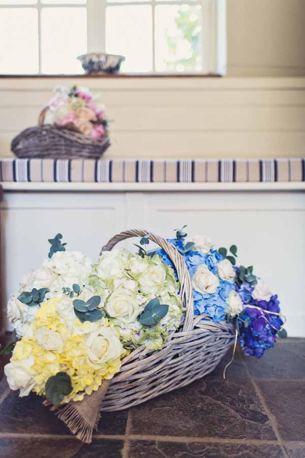 bridesmaids bouquets yellow blue in basket