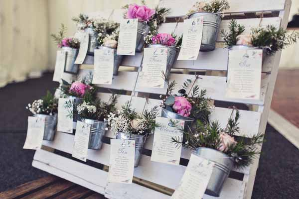 wedding table plan flowers in buckets on wooden pallet (2)