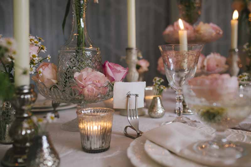 Elegant wedding table centres blush pink roses in clear glass crystal bowls vases decanters cake stands by Passion for Flowers (2)