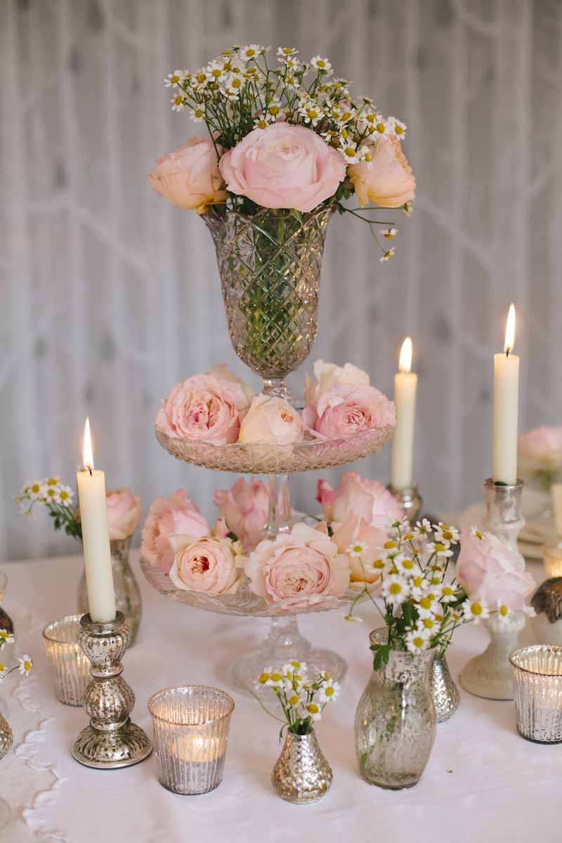 Elegant wedding table centres blush pink roses in clear glass crystal bowls vases decanters cake stands by Passion for Flowers (3)