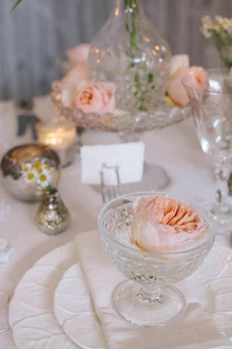 Elegant wedding table centres blush pink roses in clear glass crystal bowls vases decanters cake stands by Passion for Flowers (4)