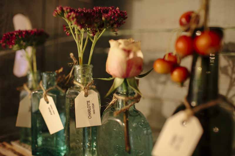 Escort Cards in Bottles of FlowersHampton Manor Wedding Florist Passion for Flowers (44)