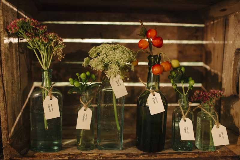 Escort Cards in Bottles of FlowersHampton Manor Wedding Florist Passion for Flowers (45)
