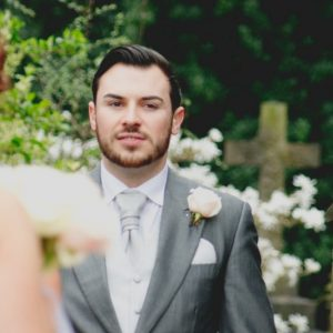 groom-button-hole-rose-hampton-manor