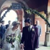 hand held floral arch for bride and groom