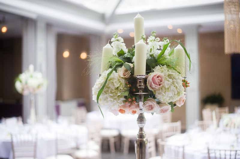 Candelabra centrepiece Hampton Manor Wedding Flowers Passion for Flowers