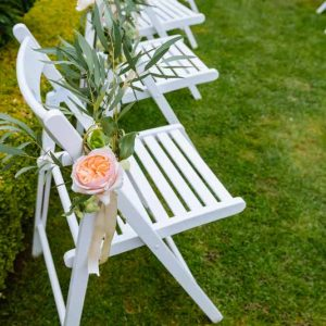 Outdoor-wedding-ceremony-aisle-decorations-of-flowers-and-trailing-ribbon-peach-Juliet-David-Austin-roses-by-Passion-for-Flowers-