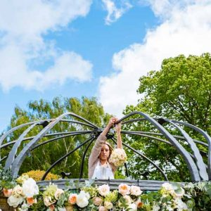 Passion-for-Flowers-behind-the-scenes-hanging-flowers-for-outdoor-wedding-ceremony