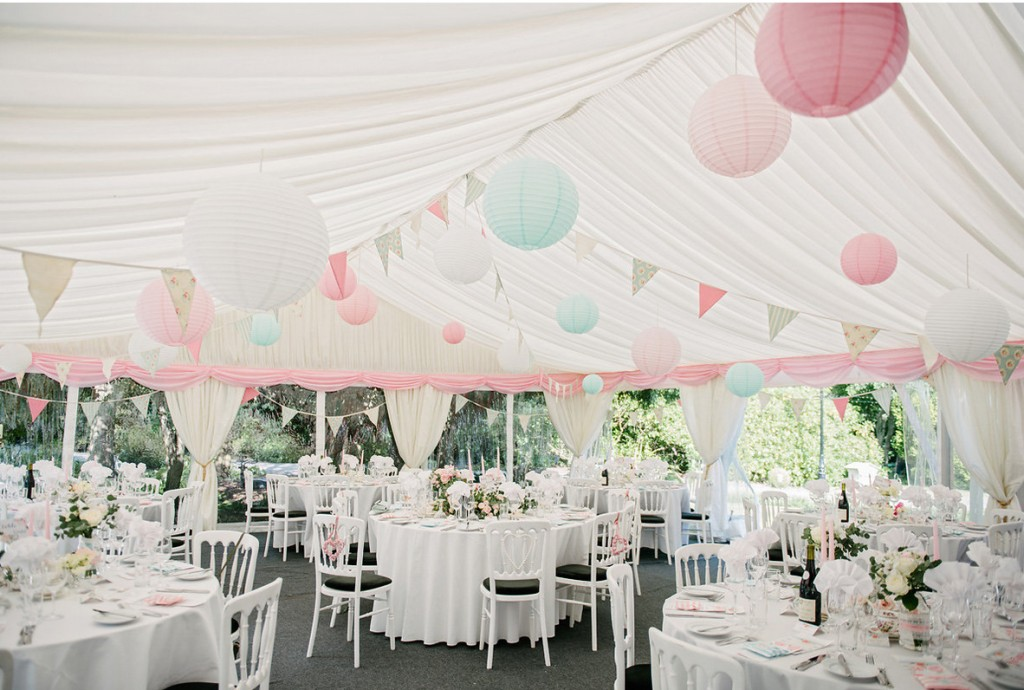 Pastel Paper Lanterns Hanging from Marquee Ceiling