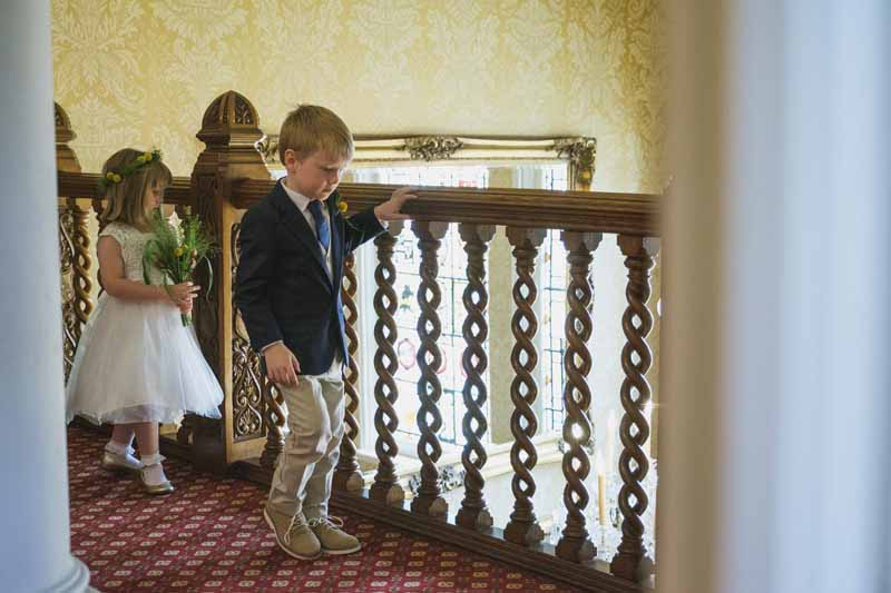 flower girl and page boy excited before the wedding ceremony