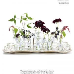 purple flowers in bottles for escort cards wedding flowers magazine