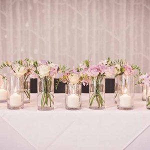 ceremony table flowers glass vases hampton manor wedding flowers by passion for flowers