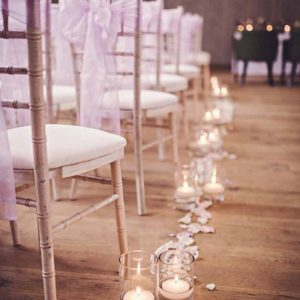 glass vases with candles aisle decorations with fresh rose petals hampton manor wedding ceremony by passion for flowers