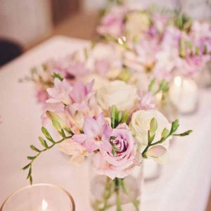 pink green wedding flowers centrepieces in glass cylinder vases hampton manor wedding flowers by passion for flowers
