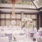 tall glass vases wedding centrepieces lilac and white flowers at hampton manor wedding flowers by passion for flowers