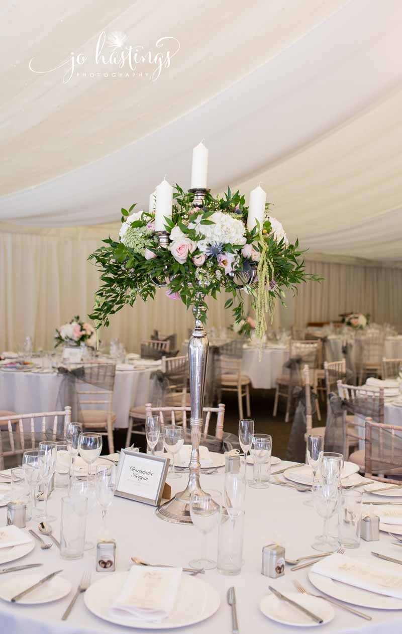 1m tall candelara wedding centrepieces marquee wedding - florist Passion for Flowers based in West Midlands UK