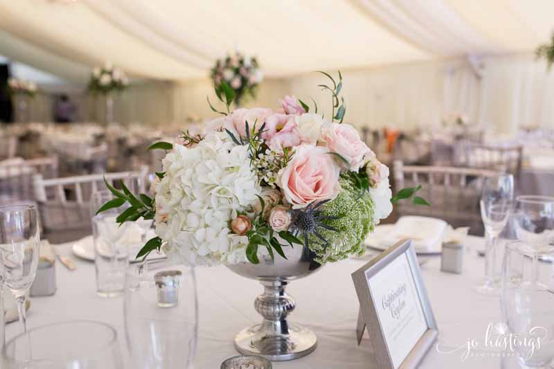 Silver footed bowl centrepieces with blush pink roses, dusty blue thistles white hydrangeas and foligae at Heath House wedding (1)
