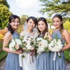 dusty blue bridesmaids dresses dusky pink roses, blue thistles and white hydrangea bouquets (1)