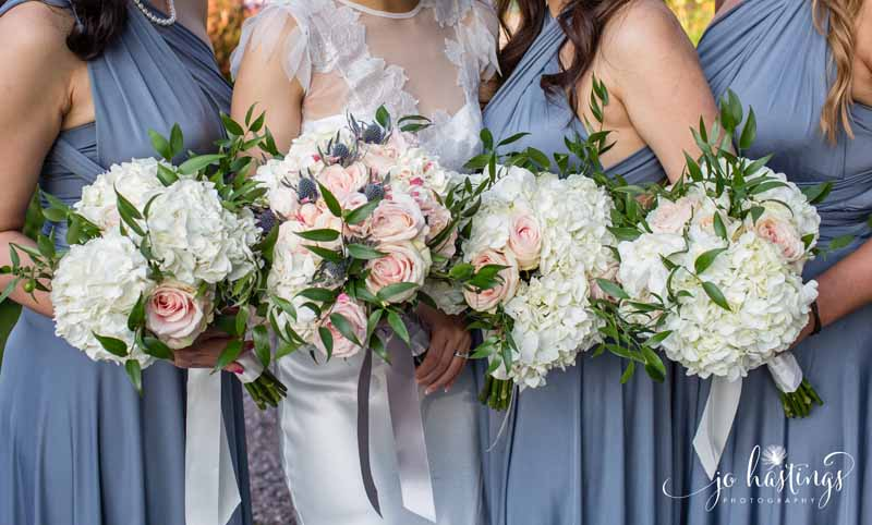 dusty blue bridesmaids dresses dusky pink roses, blue thistles and white hydrangea bouquets (2)