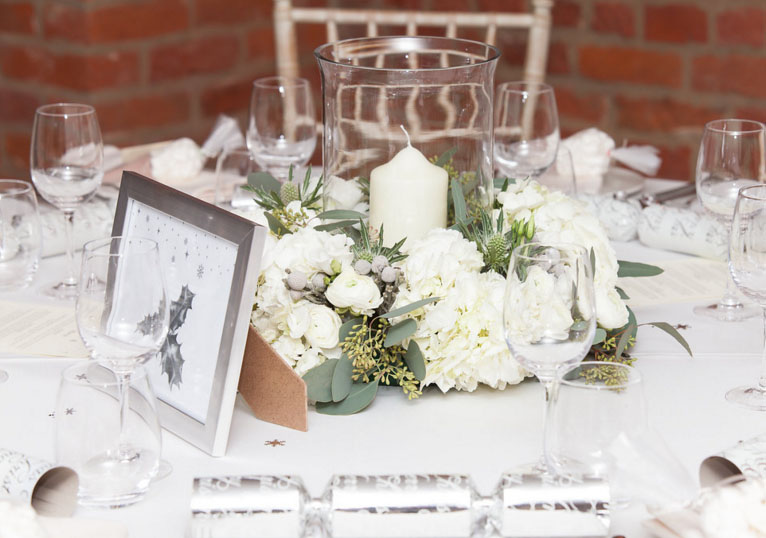 winter wedding centrepiece idea by @kmorganflowers Passion for Flowers grey and white ring of flowers around hurricane lantern