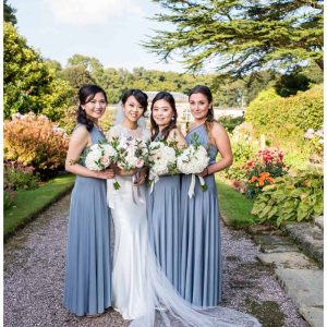 Bridesmaids flowers - bouquets with long grey blue bridesmaid dressed. Flowers by @kmorganflowers Passion for Flowers