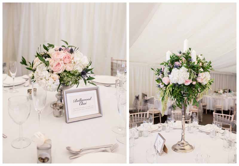 Tall and low wedding centrepieces elegant silver candelabra and silver foted bowl. Wedding flowers by @kmorganflowers