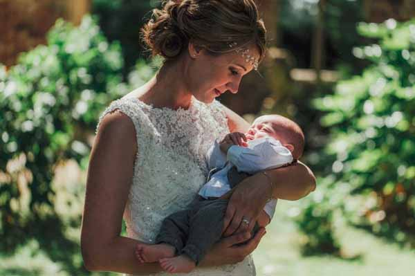 Beautiful bride and her baby