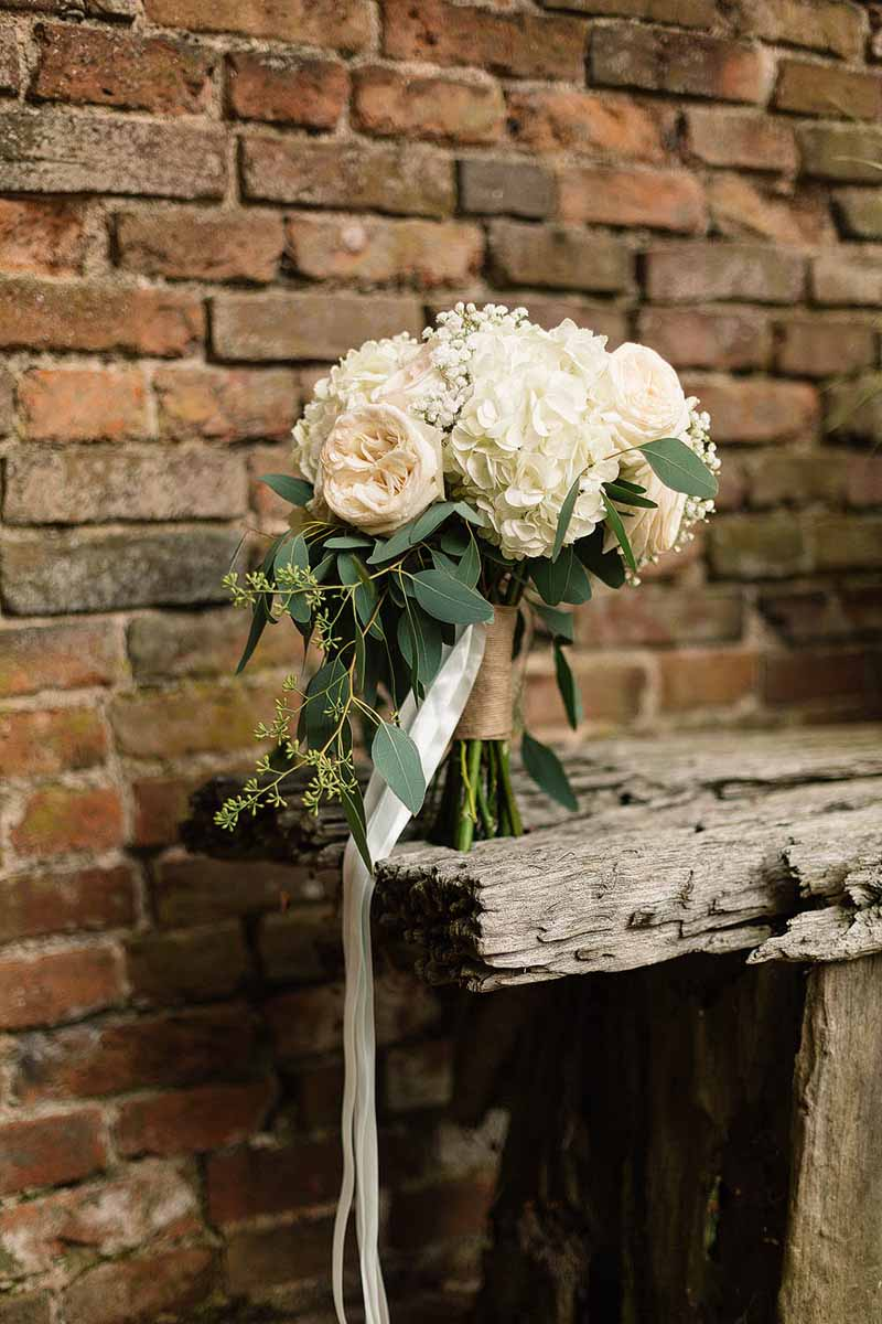 Cream-roses-and-hydrangea-bouquet-tied-with-rustic-chord-and-trailing-ribbon-Florist-Passion-for-Flowers-@kmorganflowers