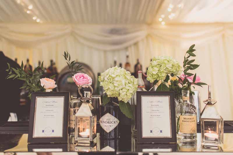 Dont forget to add flowers to your bar area at your wedding - Passion for Flowers @kmorganflowers
