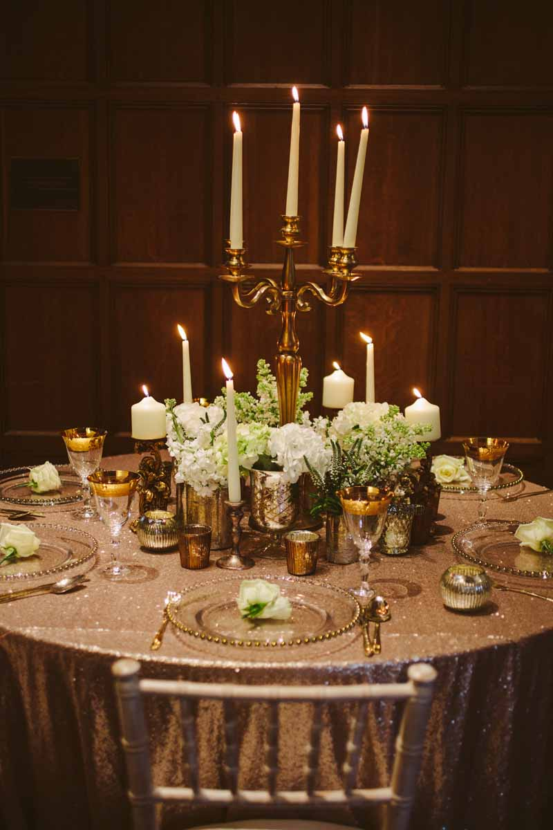Elegant gold wedding centrepieces candleabra with white flowers by Passion for Flowers @kmorganflowers (1)