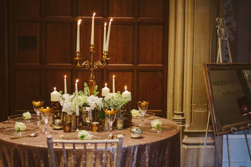 Elegant gold wedding centrepieces candleabra with white flowers by Passion for Flowers @kmorganflowers (2)