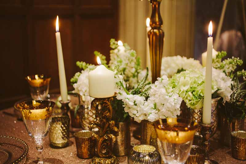 Gold wedding centrepieces add lots of gold vases and vessels around the base of candelabra for more impact on your tables By @kmorganflowers (1)
