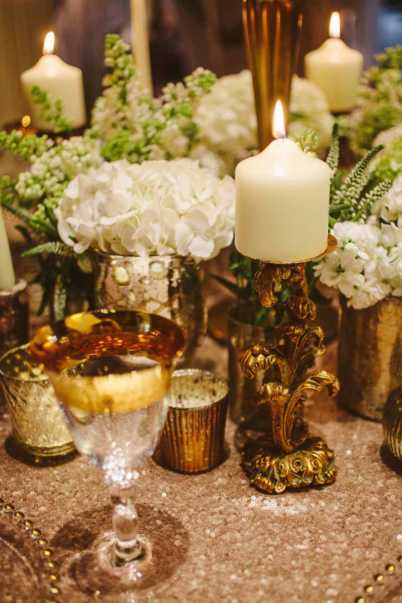 Gold wedding centrepieces add lots of gold vases and vessels around the base of candelabra for more impact on your tables By @kmorganflowers (2)