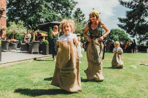 Outdoor garden games for weddings sack racing