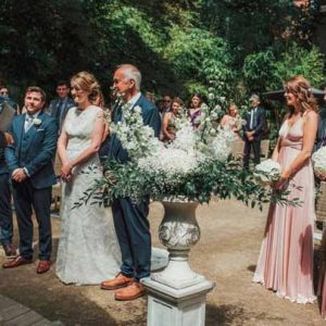 Outdoor wedding ceremony urns by @kmorganflowers Passion for Flowers