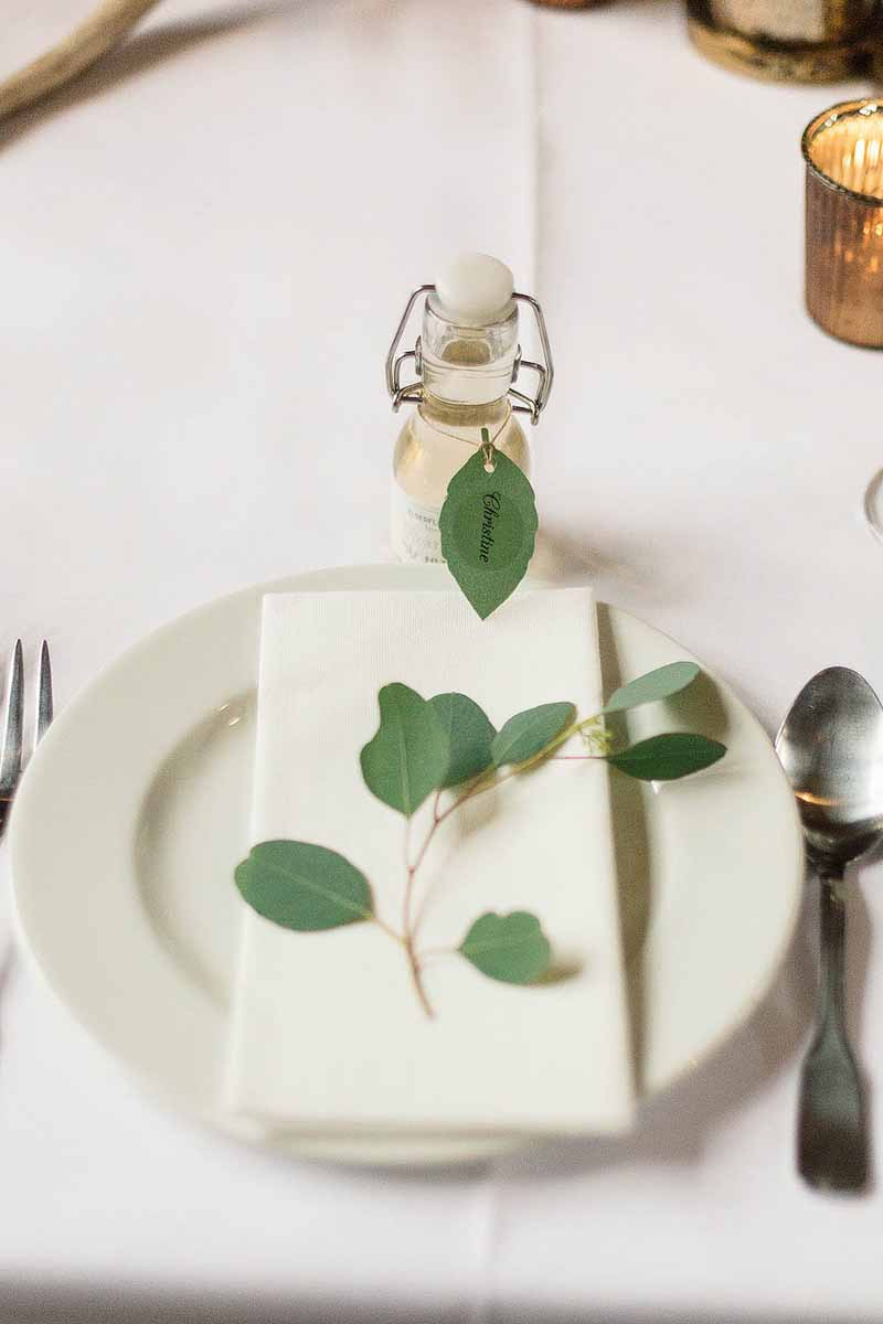 Pretty-place-settings-a-snippet-of-eucalyptus-Florist-Passion-for-Flowers-@kmorganflowers
