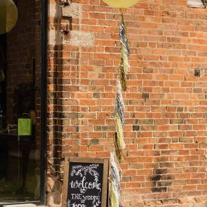 Shustoke-Farm-Barns-Wedding-balloons-and-chalkboard-welcome-sign