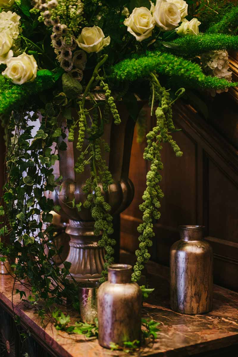 Stunning gold urn with antique gold vases and vessels around the base on a wedding entrance table by @kmorganflowers (1)