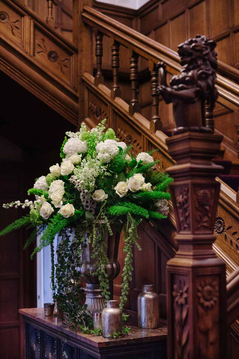 Stunning gold urn with antique gold vases and vessels around the base on a wedding entrance table by @kmorganflowers (2)