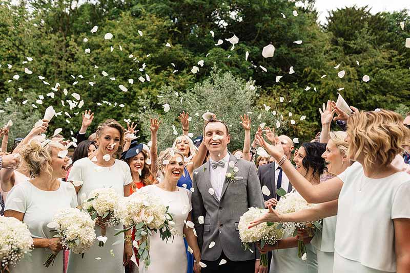 The-perfect-confetti-shot-at-Shustoke-Farm-Barns-Wedding-Florist-Passion-for-Flowers-@kmorganflowers