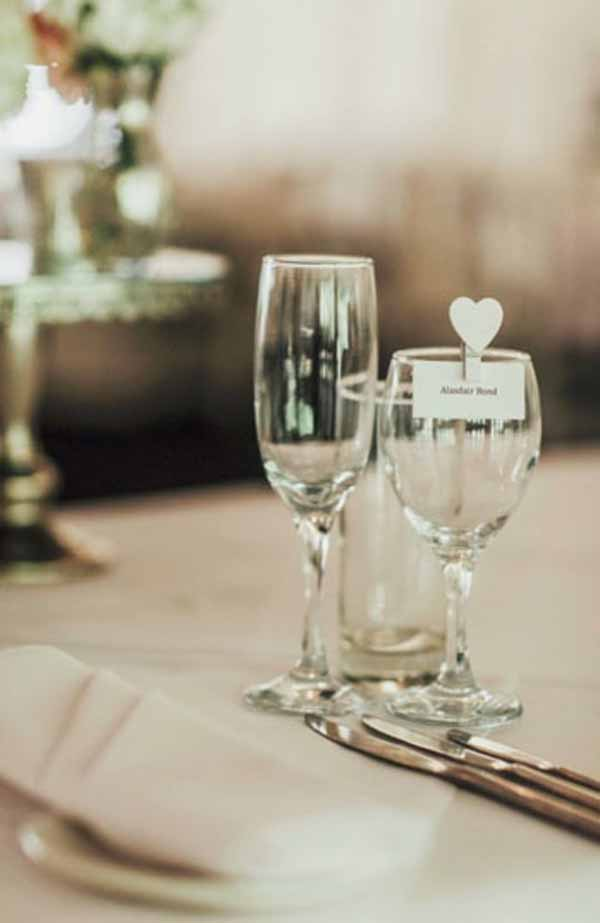 Use white heart pegs to clip name cards to wine glasses